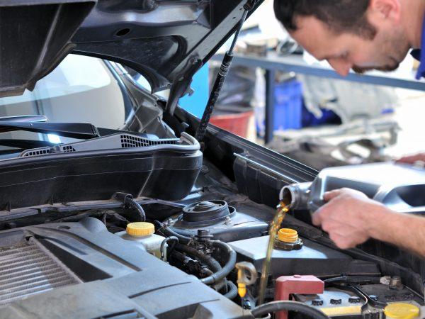 mechanic performing oil change